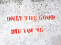 Quote on concrete wall Stock Photo
