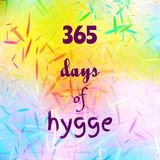 Quote 365 days of hygge on colorful abstract bright background with small particles. Decorative design texture. Festive overlay. Quote 365 days of hygge Royalty Free Stock Photo