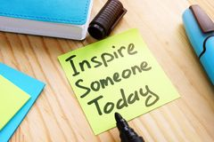 Quote Inspire someone today on desk. royalty free stock images