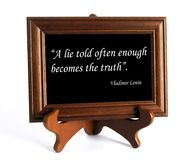 Quote about lie and truth. Wooden stand with quote about lie and truth by Vladimir Lenin as the concept of counteracting against fake news royalty free stock photo