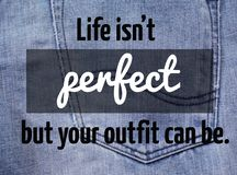 Life Quote. Quote `life is not perfect but your outfit can be` on blurred Jeans background Royalty Free Stock Photo