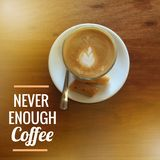 Coffee Quote. Quote `never enough coffee` on blurred background with vintage filter royalty free stock images