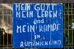 A quote old plate with text in German language. An old plate fixed on a iron fence in the north of Bucharest city. The plate has a text written in German Royalty Free Stock Photo