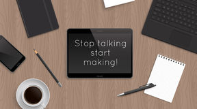 Quote Sop talking start making in tablet on office table. Royalty Free Stock Photography