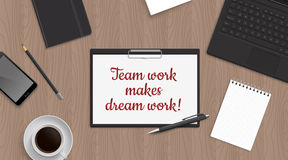 Quote Team work make dreamwork in tablet on office table. Stock Photo