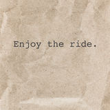 Quote Typographical Background with words Enjoy the ride over pa Royalty Free Stock Photo