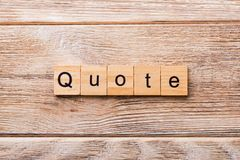 Quote word written on wood block. Quote text on wooden table for your desing, concept royalty free stock images