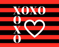 Quote: XOXO hugs and kisses in typography. In a bold red and black stripe and with a large white heart stock illustration