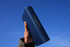 Qur'An On Blue Sky Stock Images