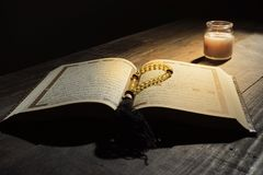 The Qur`an, the holy book of Islam. worship month of Ramadan, reading the scriptures by using a candle light.