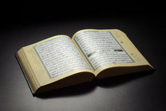 Quran Book. Islamic Book Holy Quran Under Soft Light on Black Background stock photos