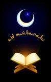 Quran on Eid Mubarak background Stock Photos