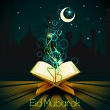 Quran on Eid Mubarak background Royalty Free Stock Image