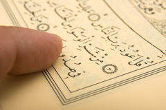 Quran and finger Royalty Free Stock Photography