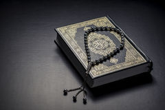 Quran Holy Book and Beads Stock Photo