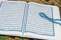 Quran,Islam book with rosary. The holy Quran ,Islam book with rosary Royalty Free Stock Images