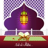 Quran with lamp on Eid Mubarak background Stock Photos