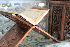 Quran and lectern. Close up image stock photos