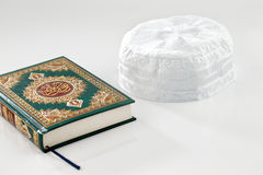 The Quran literally meaning the recitation, is the central religious text of Islam. Which Muslims believe to be a revelation from God or Allah Stock Photos