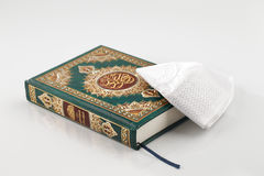 The Quran literally meaning the recitation, is the central religious text of Islam Stock Photos