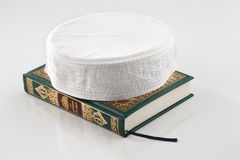 The Quran literally meaning the recitation, is the central religious text of Islam Stock Images
