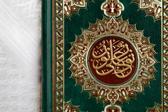 The Quran literally meaning the recitation, is the central religious text of Islam. Which Muslims believe to be a revelation from God or Allah Royalty Free Stock Images