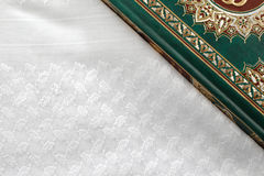 The Quran literally meaning the recitation, is the central religious text of Islam. Which Muslims believe to be a revelation from God or Allah Royalty Free Stock Photo