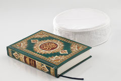 The Quran literally meaning the recitation, is the central religious text of Islam Stock Photography