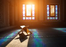 Quran in the mosque. Quran - holy book of muslims, scene in the mosque at Ramadan time stock photo