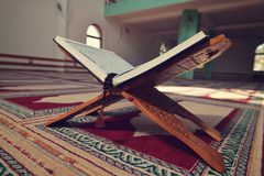 Quran in the mosque - open for prayers.  Royalty Free Stock Photos