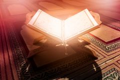 Quran in the mosque - open for prayers.  Stock Photos