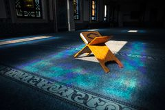 Quran in the mosque. Quran - holy book of muslims, scene in the mosque at Ramadan time stock photos