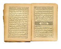 Quran. Opened old Quran on white background Royalty Free Stock Photo