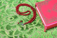 Quran, rosary beads. Stock Photos