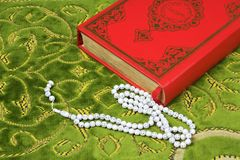 Quran, rosary beads. Royalty Free Stock Images