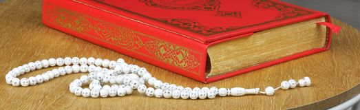Quran, rosary beads. Royalty Free Stock Photo