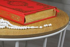 Quran, rosary beads. Stock Images
