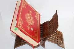 Quran and rosary beads on white background. Red koran book. royalty free stock images