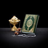 Quran With Rosary, Censor and Dates Stock Photo