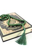 Quran with rosary Stock Image