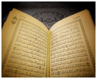 Quran - Surah al-Jinn. Two pages from the Holy Quran - the Divinely revealed book of the Muslims royalty free stock images