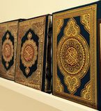 Quran. Three holy quran books on a shelf royalty free stock photography