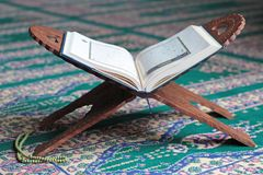 Quran on a wooden stand in mosque. Quran is holy book religion of Islam stock photos