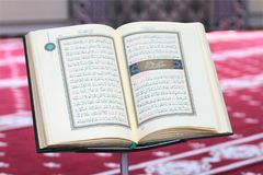 Quran, on a wooden stand in mosque. Quran is holy book religion of Islam Stock Photos