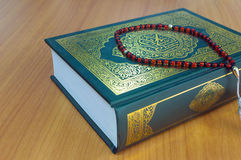 Quran on the wooden table. Background stock image
