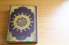Quran on the wooden table Royalty Free Stock Photos