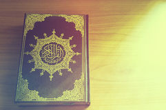 Quran on the wooden table Stock Images