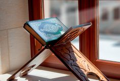 Quran, on wooden table in mosque stock photos