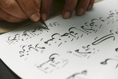 Quranic Calligraphy Transcription on Paper. Islamic Sacred Verse. (Khat). The craft of transcribing the Quran in Islamic or Arabic calligraphy. The traditional Stock Photos