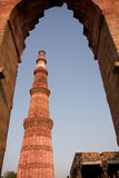 Qutab Minar  through arch, Delhi, India. Qutab Minar  is an old mughal column whihc is the highest minaret in India Royalty Free Stock Image
